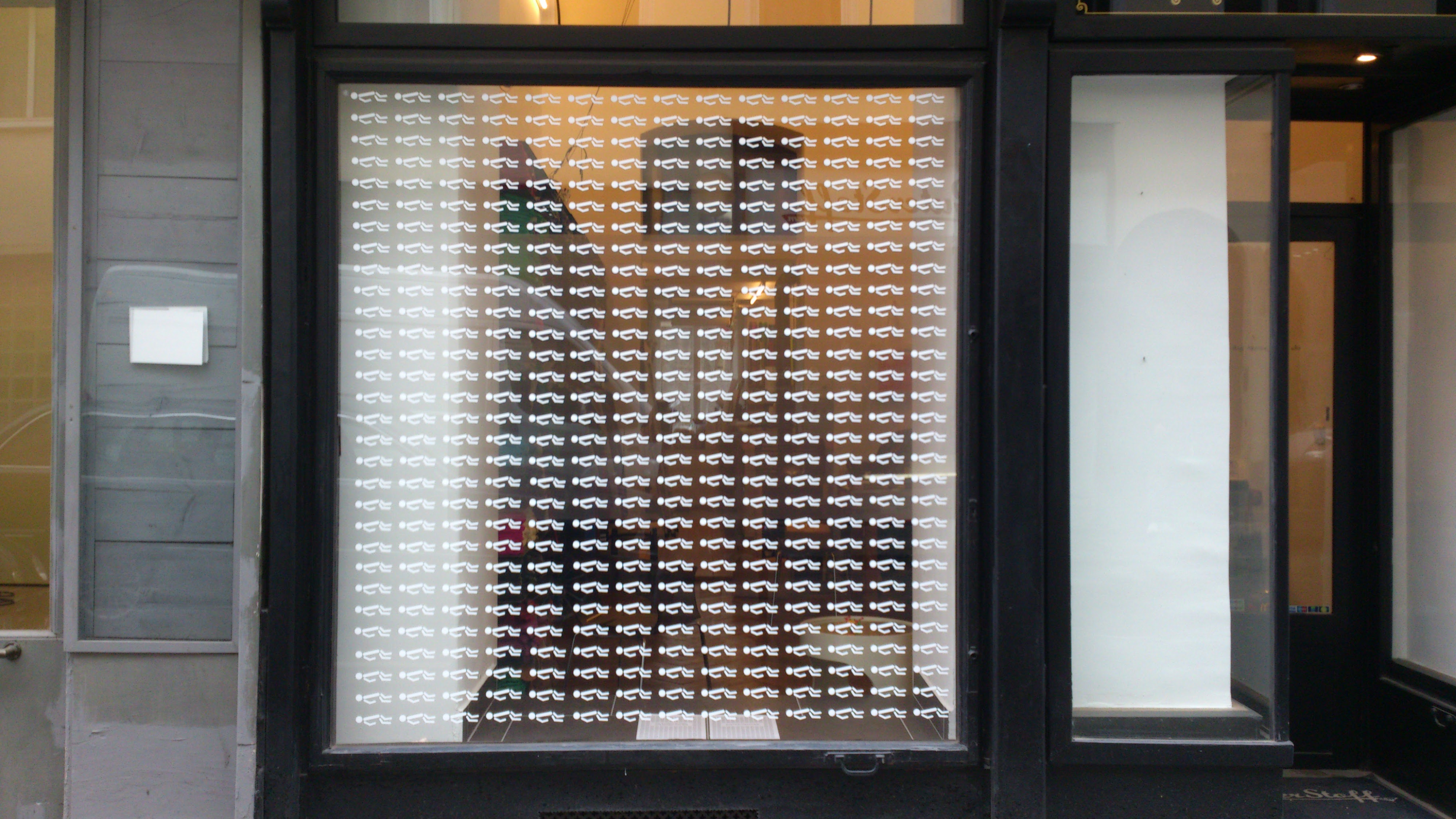400 refugee victims storefront with 400+ pictograms